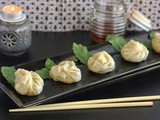 Steamed dumplings with chili dipping sauce