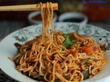 Veggie noodles in tomato walnut sauce -Indo-chinese