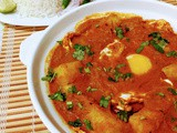 Desi style poached egg curry