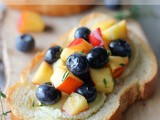 Goat Cheese Crostini with Blueberry and Peach Thyme Salsa