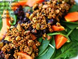 Blueberry and basil, papaya, spinach salad with a chilli and agave pistachio nut topping
