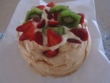 Pavlova filled with cream and fresh fruits