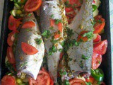 Moroccan baked stuffed fish with vegetables