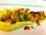 Shrimp and Grits topped with bacon