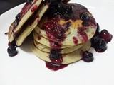 Blueberry Banana Pancakes with a blueberry syrup