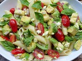 Avocado pasta salad with tomatoes and feta cheese or queso fresco