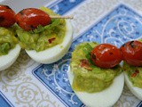Deviled Eggs with Guacamole and grilled Cherry Tomatoes