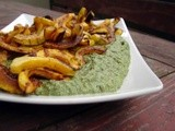 Roasted delicata squash over spinach white bean purée