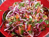 Piyaz Salad with red onions, tomatoes, parsley and sumac