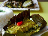 Fish Paturi Or Bhetki Macher Paturi Or Marinated Steamed Fish in Banana Leaf Parcel