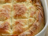 Cheese pie with Xinomyzithra and Bechamel Sauce