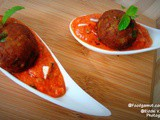 Cottage cheese & green chutney kofta in red curry