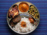 Mangalorean Plated Meal Series - Boshi# 29 - Ambadyanchi Kadi, Mitgi Sango Miryapito, Fried Fish, Fried Pathrode, Pickle & Rice