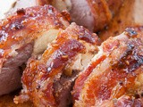 Bacon-Wrapped Stuffed Pork Tenderloin with Raspberry Chipotle Sauce