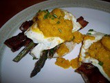 Eggs, bacon, and asparagus with a roasted yellow pepper sauce