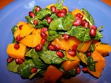 Roasted butternut squash with baby spinach and pomegranate
