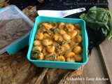 Basale Chemmeen Kadumbu / Steamed Rice Dumplings in Prawns and Malabar Spinach Gravy