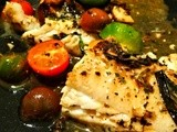Pan fried and the roasted cod in a sauce of fresh vegetables and herbs