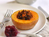 Vegan stuffed butternut squash with cranberry and juniper sauce