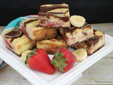 Chocolate Marbled Strawberry Bananas Foster Cheesecake Bars
