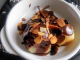 Steamed pears served with chocolate sauce and roasted almond flakes